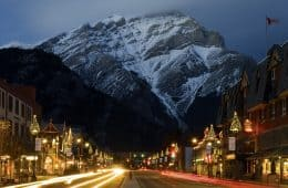 Banff, Banff National Park, Alberta, Canada --- Banff, Alberta, Canada; Banff Avenue Illuminated At Night --- Image by © Philippe Widling/*/Design Pics/Corbis