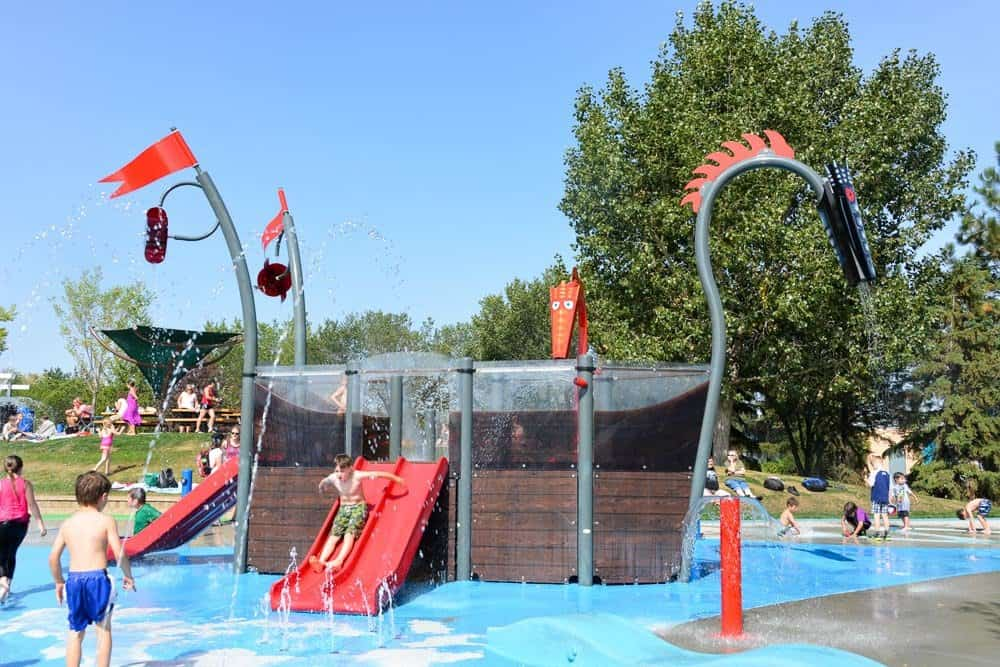 Broadmoor Lake and Woodlands Spray Park Open TODAY